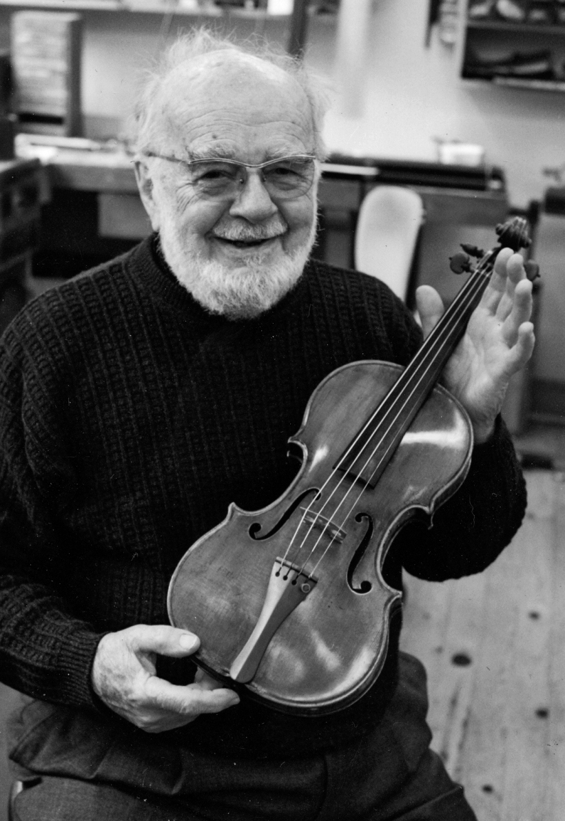 Edouard Bartlett - a great gardener of young players.  Photo by John Newton of Ed at Heinl's with a Stradavarius violin, looking cheeky.