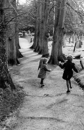 My family lived in London England in 1967-68.  Here my sister and I skip through a graveyard...
