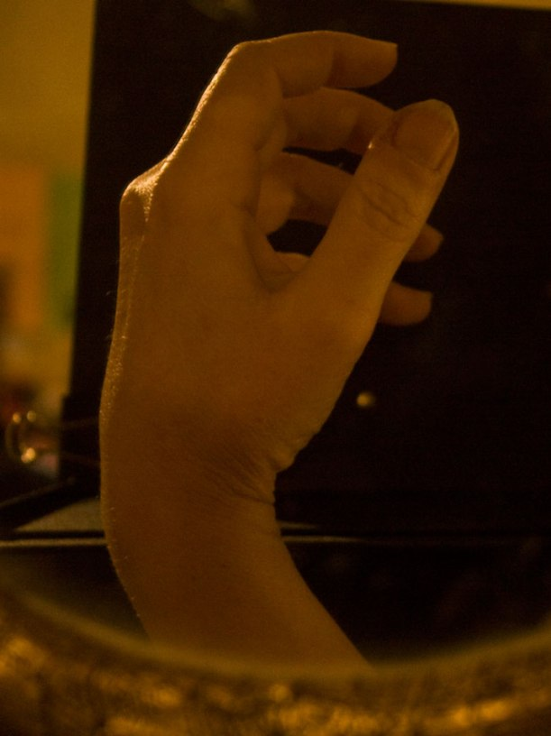 Awkward shot of my Right hand in a mirror for reference, Feb.  Music stands work as a matte black ground...