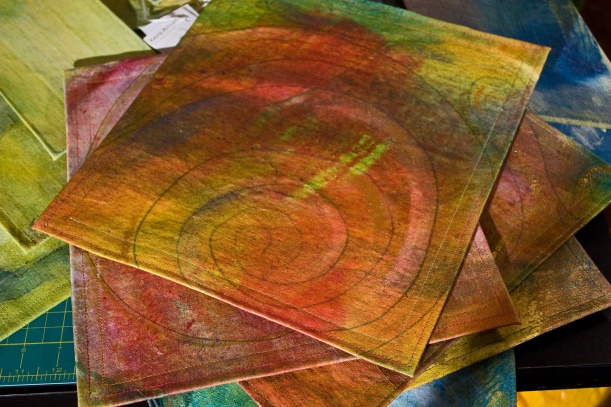 spiral set of four placemats with felt backing.  double-sewn on edges