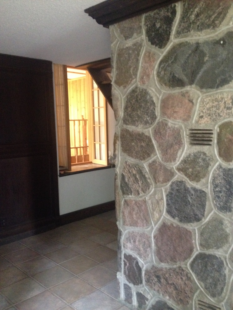 Fireplace - designed by dad, and build by an artist-stonemason circa 1973.  Back room (to balance the cool dark cave of the schoolhouse), designed by dad, and built by him, my mom and all their friends.
